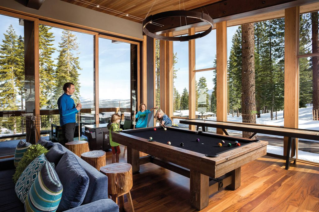 family enjoying tree house amenities with views of tahoe