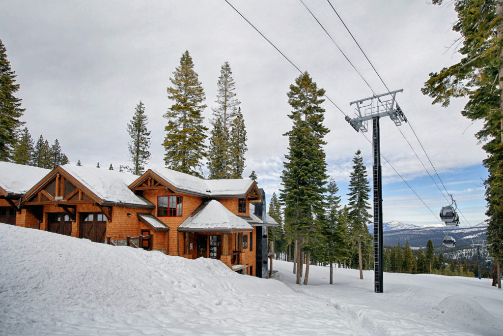 Lake Tahoe Truckee luxury real estate townhomes exterior winter shot next to northstar ski lift