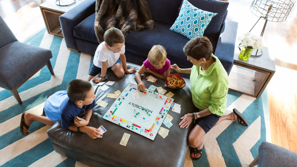 family playing board games in tree house truckee northstar real estate