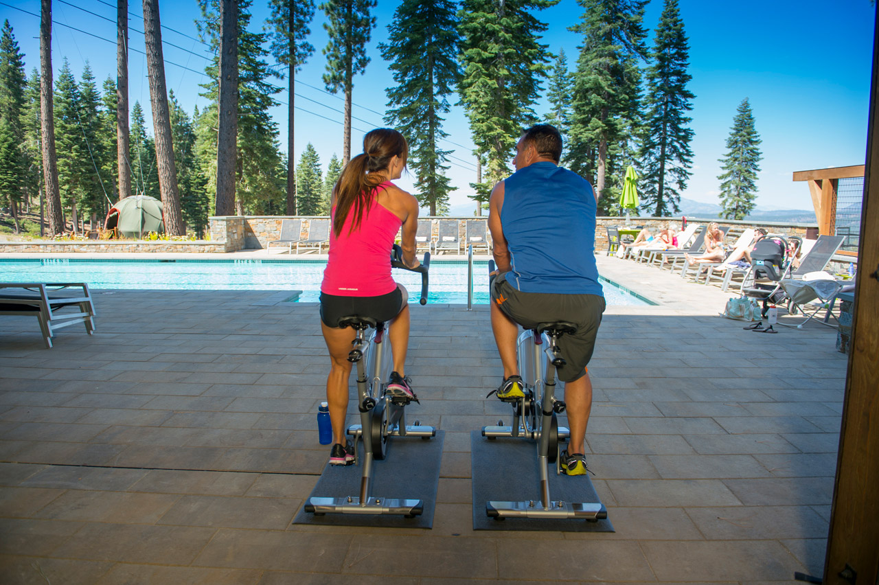 couple working out next to community pool in tahoe truckee community northstar martis