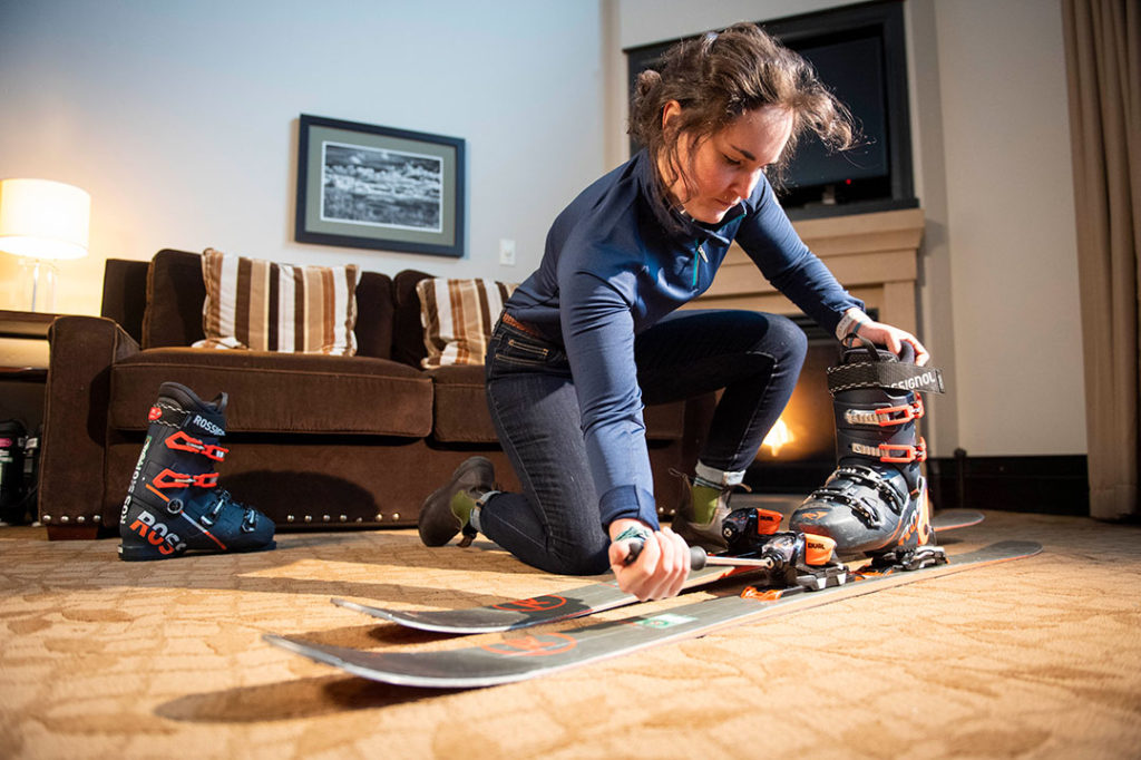 ski butler customer setting up rental skis
