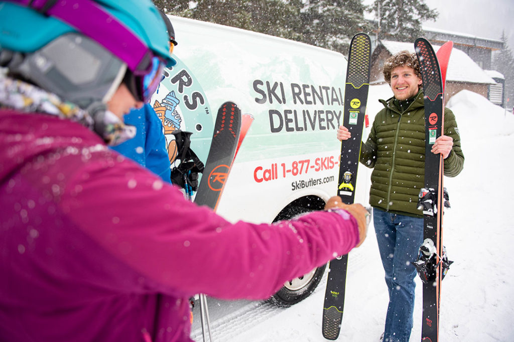 Ski Butler delivering skis on the mountain